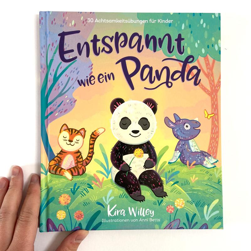 """Buch """"Entspannt wie ein Panda"""" Cover mit Hand"""