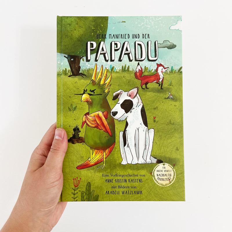 Kinderbuch-Papadu_Buchtitel mit Hand
